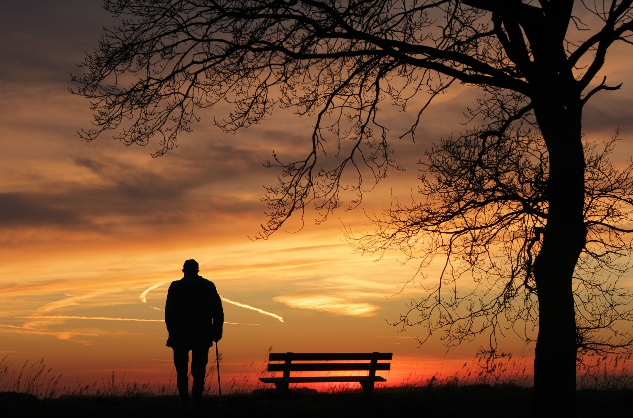 man standing alone near a bench